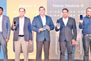 Isuru Dissanayake (Senior General Manager, Marketing, Mobitel (Pvt) Ltd), Ranjan Perera, Executive Director/Sector Head - Mobile Division, Softlogic Holding PLC,  Nalin Perera, Chief Executive Officer - Mobitel (Pvt) Ltd), Dharmesh Naicker (Business Manager, HMD Global, Sri Lanka & Nepal), Sandeep Gupta, General Manager, HMD Global at the launch in Colombo recently.