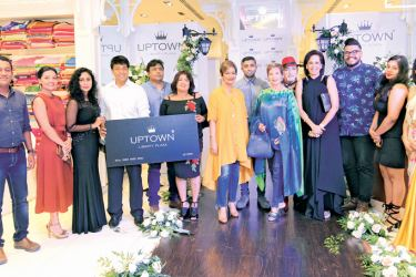 Celebrities Bathiya Jayakody, Soraya de Zoysa, Ramanie Fernando, Yoland Aluwihare, Danu, and Gerald Solomons, who were presented with the first Loyalty Card,  together with the management of the Uptown Group.