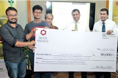 President of ReForest Sri Lanka - Achala Meddegama and team member receiving the cheque from Chairman of MFPLC and President's Counsel  Kuvera De Zoysa, Sundari De Alwis –Director Fairway Group, and Executive Director/CEO of MFPLC - Pushpike Jayasundera at the launch of the 'Each One Plant One' campaign.