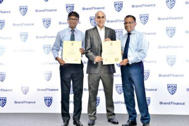 The Bank of Ceylon's CEO/General Manager Senarath Bandara and the Chief Marketing Officer Dr. Indunil Liyanage received the certificates carrying the titles awarded to the Bank from the Managing Director Brand Finance Lanka Ruchi Gunawardene recently