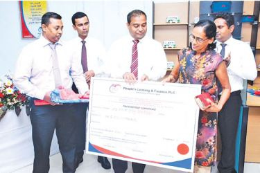 Ranil Perera, Assistant General Manager is seen handing over a FD certificate to a customer