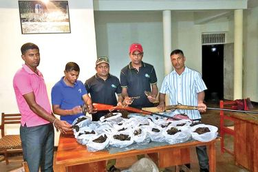 Wildlife officials with the seized meat.