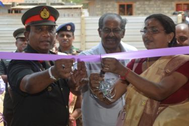 MP Mavai Senathirajha and  Jaffna security forces Commander Maj. Gen. DharshanaHettiarachchi opening a house on April 5.