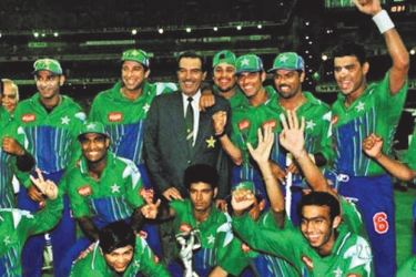 The Pakistan team pose with the Man-of-the-Match award