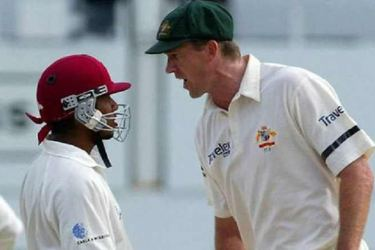 Australian paceman Glenn McGrath and West Indies batsman  Ramnaresh Sarwan sledge each other.