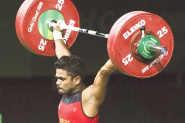 Weightlifter Indika Dissanayake on his way to winning a Silver in the 69 kg category.
