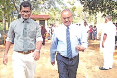 Dr. Ashoka and Presidential Task Force on Prevention of Chronic Kidney Diseases Head Asela Iddawela at the inauguration of the water treatment and distribution centre. Picture by Mahaweli Systems Group Corr.