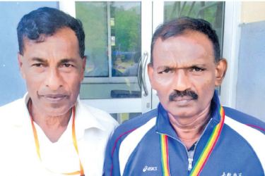 K.S. Chandrapala representing Kalutara District in the 50-54 age category 5000m race walk won the silver medal in at the recently concluded 10th Open All Island Veterans Athletic Meet held at the Jayathilaka Stadium, Nawalapitiya. K.S.Chandrapala (right) with his coach P.B. Seneviratne.