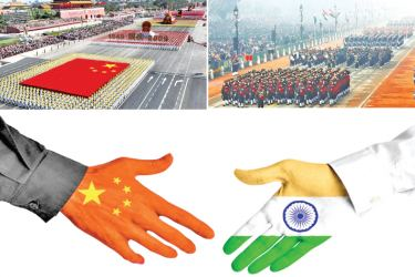 Chinese and Indian Forces show their might at Independence Day celebrations.