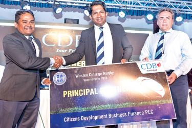 The sponsorship cheque is presented by Senior Assistant General Manager – Marketing of CDB Darshana Jayasinghe to Principal of Wesley College Avanka Fernando and Head of Rugby Development Committee Capt. Naween De Silva