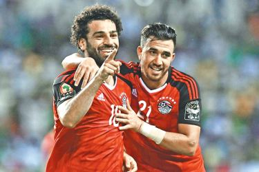 Salah (L) celebrates with Egypt's midfielder Mahmoud Hassan after scoring a goal during the 2017 Africa Cup of Nations