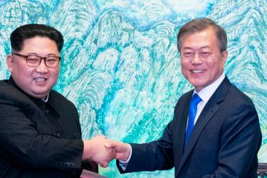 In this April 27, 2018 file photo, North Korean leader Kim Jong Un, (L), and South Korean President Moon Jae-in shake hands after signing on a joint statement at the border village of Panmunjom in the Demilitarized Zone, South Korea.
