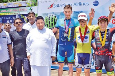 The top three riders at the Sri Lanka T-Cup Cycle Tour  2018  overall winner Yoshiharu Nakajima (yellow jersey), flanked by Best Sprinter Stepan Astafyev (blue jersey) and Yoshimitsu Hiratsuka (red Jersey) after receiving their awards from Gayan Peiris, General Manager Sri Lanka Holidays Ltd. Thilak Weerasinghe, organizer and conductor of the Sri Lanka T-Cup Cycle Tour 2018, Mayor of Negombo Municipal Council Dayan Lansa and president of Cycling Federation of Sri Lanka N. Karunaratne are also present. Pic.