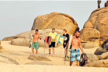 The tourist season for Sri Lanka's east coast is fast approaching with Arugam Bay being the center of attraction for surfers. It's a very popular surfing destination among European and Australian travellers. With SriLankan launching direct flights to Australia, more Australians are expected this season. Here some tourists returning after surfing in Arugam Bay. Picture by Sulochana Gamage