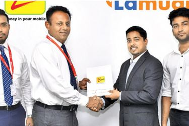 Udaya Jayasundera, Chief Manager - Merchant Acquisition and Sales, Mobile Money, Dialog Axiata PLC handing over the agreement to Nitesh Khirwal, Managing Director - Lamudi Lanka (Pvt) Ltd. (from left) whilst Jeewaka Keerthisinghe, Account Manager - Enterprise Sales, Mobile Money, Dialog Axiata PLC and Raga Navam, Content Manager - Lamudi Lanka (Pvt) Ltd, look on.