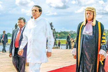 President Maithripala Sirisena arriving in Parliament to open the new sessions of parliament yesterday flanked by Speaker Karu Jayasuriya and Secretrary General Dhammika Dassanayake. Picture by Sudath Silva