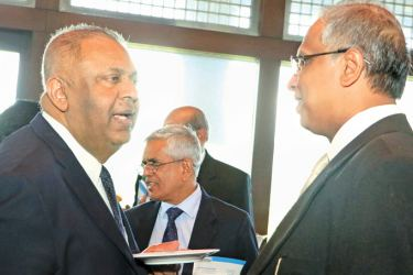 Finance and Media Minister Mangala Samaraweera in conversation with TNA Parliamentarian M.A. Sumanthiran at the tea party in Paliament yesterday.
