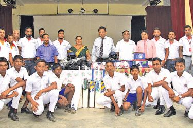 Cricket team members, school staff and LB Finance officials with the donated sports gear