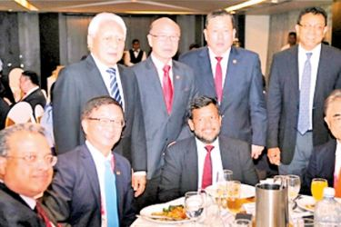 Minister of Industry and Commerce Rishad Bathiudeen, President of the Singapore Chinese Chamber of Commerce & Industry Roland Ng, Shamil Mendis, President of the Sri Lanka-Singapore Business Council and Prima Group General Manager for Sri Lanka Tan Beng Chuan at the SCCCI evening reception yesterday