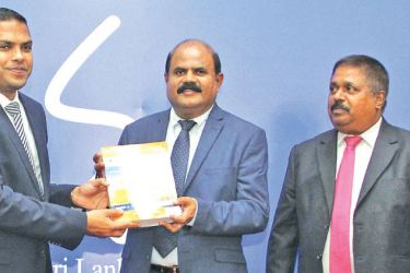The first print copy of the SLT Rainbow Pages Directory - 2018/19, the only National Business Directory published in Sri Lanka, being presented to Harin Fernando, Minister of Telecommunication, Digital Infrastructure and Foreign Employment by Kumarasinghe Sirisena, Chairman - Sri Lanka Telecom and  Malraj Balapitiya, Chief Executive Officer - SLT Rainbow Pages, recently at the ministry.