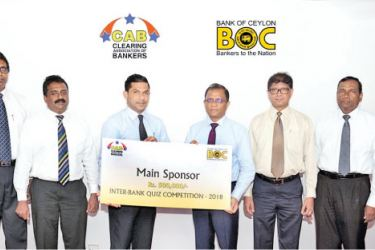 Senarath Bandara, General Manager , Bank of Ceylon hands over the sponsorship cheque to the President of the Clearing Association of Bankers, M. Razak Deen,  Indunil Liyanage, the Chief Marketing Officer, B. Nanthakumar, the AGM – Support Service, Champa De Silva, the Chief Manager of Bank of Ceylon, Anura Jayakody, the Vice President, Janak Palugaswewa, the Secretary of CAB and Duminda Dayawansa of CAB are also present.