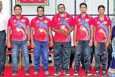 Winners of the Men's Team event – Uva Province team with  Ravi Wickramasinghe / Vice President of CFSL and Sanjula Damayanthi / Project Officer of Department of Sports Development