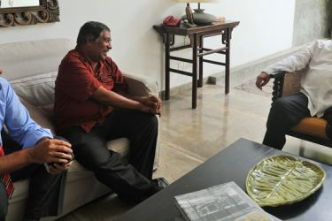 SLBC Chairman Sydney Farook and Working Director M.J.R. David in discussions with Minister Dr. Sarath Amunugama.