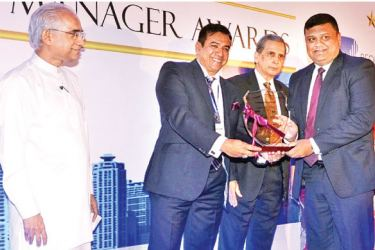 Senior Vice President Group HR Paduma Subasinghe accepting the Company with Great Manager Award on behalf of Brown & Company
