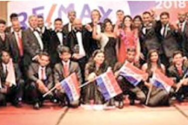 Officials from RE/MAX RE/MAX World Headquarters USA