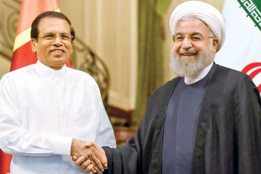 President Maithripala Sirisena who is on a two-day state visit to Iran greeting Iranian President Hassan Rouhani at the Saadabad Palace yesterday. (Picture by Sudath Silva)