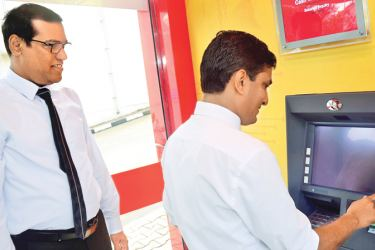 Officials opening the ATM machine.