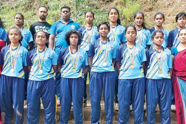 St.Anthony's Balika,Katugastota, champions of the tournament with Susantha Basnayake, the Coach and Wasanthi Jinadasa, Teacher-in-charge.