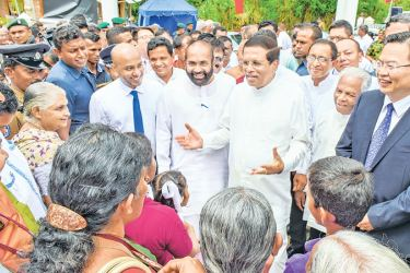 President Maithripala Sirisena speaking with the Aranayake landslide victims. Pictures by President's Media