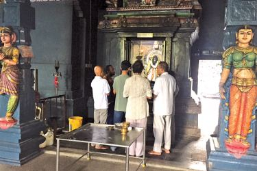 Devotees gather for a morning pooja.