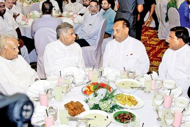 Prime Minister Ranil Wickremesinghe held his annual Ifthar at Temple Trees yesterday with the participation of several senior Muslim politicians, clerics and Government and Opposition members. Speaker Karu Jayasuriya, Opposition Leader R. Sampanthan and Minister Vajira Abeywardena shared the evening meal with the Prime Minister.  Picture by Hirantha Gunathilaka