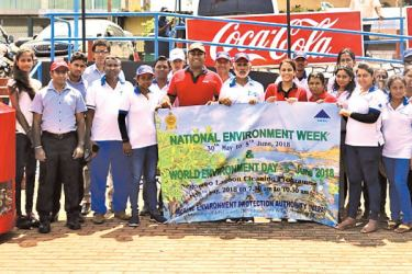 The core teams from Marine Environmental Protection Authority (MEPA) and Coca-Cola Beverages Sri Lanka (CCBSL) for the World Environment Day 2018 celebrations with the mangrove-cleaning program at the Negombo Lagoon.