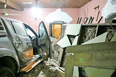 The cab that crashed into the house