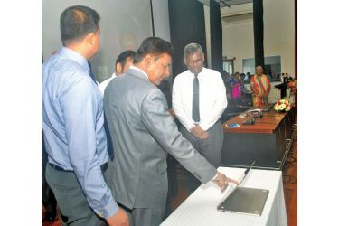 Higher Education and Cultural Affairs Minister Dr.Wijeyadasa Rajapakshe launches the new app. Picture by Siripala Halwala