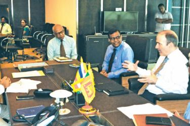 Agriculture Minister Mahinda Amaraweera, Agriculture Ministry Secretary B. Wijeratne, Sri Lanka Council For Agricultural Research Policy (SLCARP) Chairman Jerry Jayawardane and Sustainable Development Programme Leader covering Sri Lanka and the Maldives Andrew Goodland in discussion.