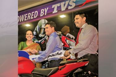 Ravi Liyanage, CEO of TVS handing over a 'Apache' motor cycle to Sangeetha Weeraratne to mark the the partnership.