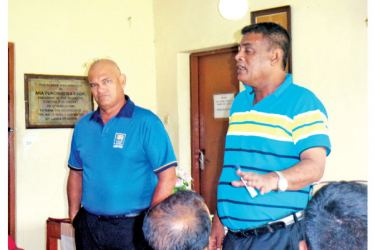 Test umpire T.H. Wijewardena stressing a point to the umpires during the seminar. Picture by Kandy Sports Special Corr.