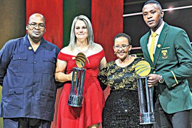 Kagiso Rabada (extreme right) and Dane van Niekerk (second from left) with their awards at the Cricket South Africa (CSA) awards function in Pretoria.