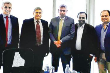 Sports Minister Faiszer Mustapha (centre) with ICC president Shashank Manohar (second from left), ICC CEO Dave Richardson, SLC CA Kamal Pathmasiri and SLC CEO Ashley de Silva at ICC head office in Dubai yesterday.