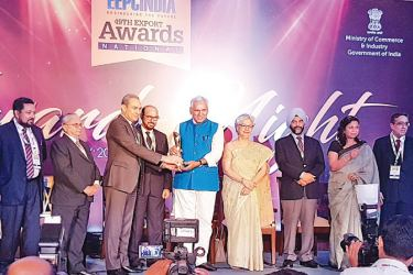 Officials from Asiatic Electrical and Switchgear Ltd of India receiving the award