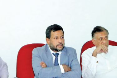 Secretary to the Ministry of Industry and Commerce K.D.N. Ranjith Asoka, Minister Rishad Bathiudeen, Eastern Province Governor Rohitha Bogollagama, and Commissioner of Co-operative Development S. L. Naseer at the Ministry of Industry and Commerce