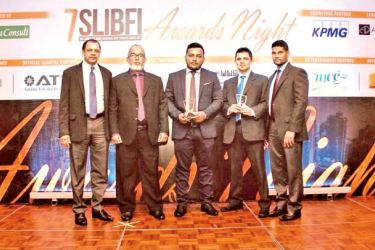 Deputy General Manager Ainsley Motha, Zakir Saly Manager, Jumel Mohamed Assistant Manager, Sulfikhan Zeinul Ameen with the awards.