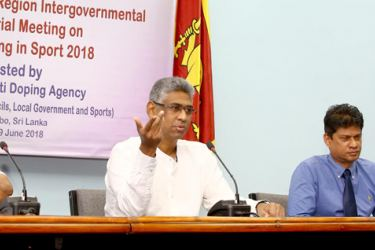Sports Minister Faiszer Mustapha addressing a media conference in connection with the 15th Asia/Oceania Region inter government Ministerial meeting on anti-doping in sports at the Government Information Department, Kirillapone yesterday. Seevali Jayawickreme, Director-General of SLADA and Professor Arjuna de Silva, chairman of SLADA are also present.