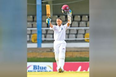 Shane Dowrich of West Indies acknowledges applause for his hundred on the second day of the first cricket Test against Sri Lanka at Port of Spain on Thursday