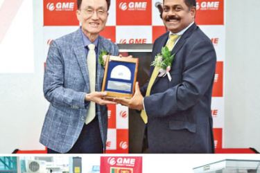 Commercial Bank's CEO, S. Renganathan (above, right) presents a commemorative plaque to John Sung, Chief Executive Officer of GME Remittance and participates (below) in a formal ribbon cutting as a symbolic gesture to commence the remittance service at GME's Ansan branch. Commercial Bank's Chief Manager eBanking and RemittancesPradeep Banduwansa (below, extreme left) and Counsellor of the Sri Lankan Embassy in South Korea Jagath Batugedara look on.