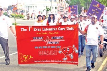 Doctors at the anniversary walk in Colombo, yesterday.  Picture by Sulochana Gamage